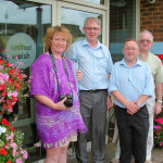 Wales in Bloom judge Clare Price with Charles Larcombe, from United Welsh Housing Association, Simon Beacham, the council's senior parks officer, and Lyndon Evans from Caerphilly in Bloom.