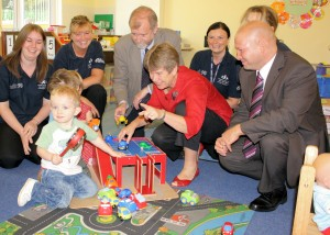 Education Minister Jane Hutt AM is pictured with three year old Brooklyn during a recent visit to the childcare facilities at Heolddu Comprehensive School Alongside her are head teacher Phil Jones and Caerphilly AM Jeff Cuthbert AM.