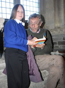 Sophie Sweeney from St James' Primary School gets her Michael Rosen poetry book signed by the author.