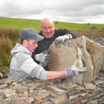 Ryan Godsell, 17, has been working alongside Commons Ranger Dave Parfitt to rebuild drystone walls in Fochriw.