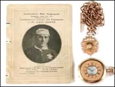 The watch and chain with a picture of Llew Jenkins.