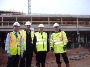From left to right, Simon Williams, Associate with Davis Langdon, Simon Davies, Associate Capital Project Director of Aneurin Bevan Health Board, Wayne David MP and Andrew Cavil, Senior Project Manager, with BAM Construction.