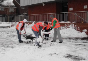Offenders help to clear snow from the Oasis Christian Centre in Cefn Fforest as part of their Community Payback.