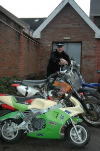 Sgt Gareth Jones, with some of the surrendered off-road bikes.