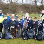 Pupils from Ysgol Gymraeg Caerfilli with PCSO Taylor (back left) and safety warden Lloyd (back right).