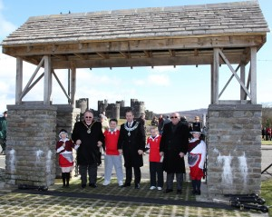 School children join dignitaries as they walk through the new Eiseddfod Gates in Caerphilly.