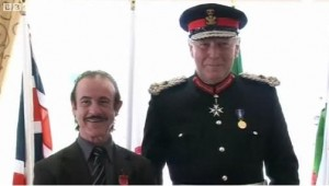 Enzo Calzaghe with the Lord Lieutenant of Gwent, Simon Boyle, who presented the trainer with his MBE