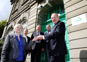 Cllr Ron Davies, Cabinet Member for Regeneration and Countryside handing over the keys of Ty Mynyddislwyn.