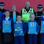 (Back row, left to right) PCSO Eve Churchward, Pam Farrant (Greater Bargoed Communities First Partnership), CSW Allan Davies and PCSO Cath Jones. (Front row, left to right) Pupils from years 4 and 6 at Ysgol Bro Sannan, Aberbargoed.