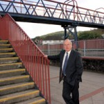 Cllr Ron Davies at the railway footbridge in Caerphilly town threatened with closure
