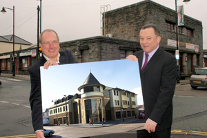Cllr Ron Davies and council leader Lindsay Whittle with an artist's impression of the new building to replace the old Post Office