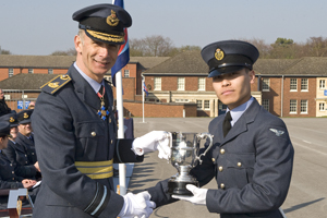 Piya receiving his trophy from Air Vice Marshall Mark-Green