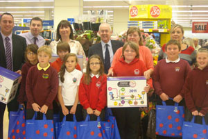 Wayne David, Caerphilly MP, with some of the schoolchildren at Tesco Ystrad Mynach