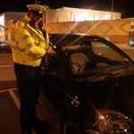 A police officer checks a car at Blackwood Asda