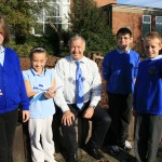Derek Brockway with pupils at Derwendeg Primary School in Cefn Hengoed