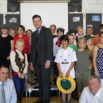 Pupils of Maescywmmer Primary School with Islwyn MP Chris Evans, centre, Councillor Robin Woodyatt, right, and new headteacher James Harris, left