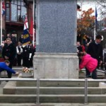 School children lay wreaths at the Armistice Day ceremony in Caerphilly town
