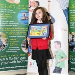 Emma Davies from Glyn Gaer Primary proudly shows off her artwork design