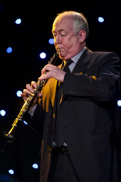 Wayne David plays his oboe at a recent charity concert