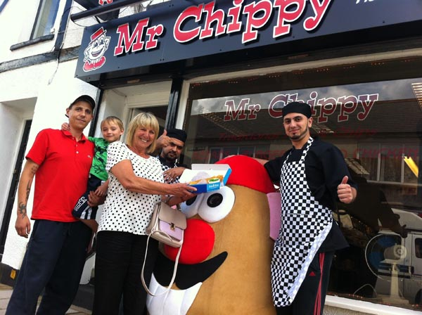 Customers Chris Hobbs, son Michael and mother Pat with Naz and Ibrar Khan outside Mr Chippy in Clive Street, Caerphilly