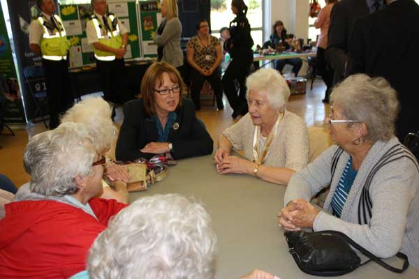 Sarah Rochira, Older People's Commissioner for Wales, speaks with members of the intergenerational club at Lewis School Pengam