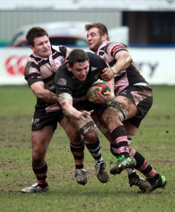 Bedwas captain Phill Sargent breaks through two Cardiff tacklers