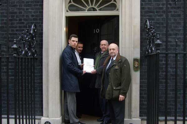 """Islwyn MP Chris Evans, Caerphilly MP Wayne David and Merthyr and Rhymney MP Dai Havard present the """"Bedroom Tax"""" petition to Number 10"""