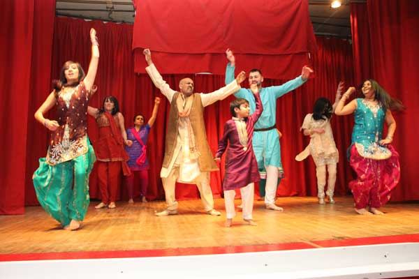 COMMUNITY: Premji Bhoja (centre left) takes to the stage with some of his customers