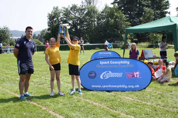 Ystrad Mynach Primary School's Yellow House lift the winner's trophy