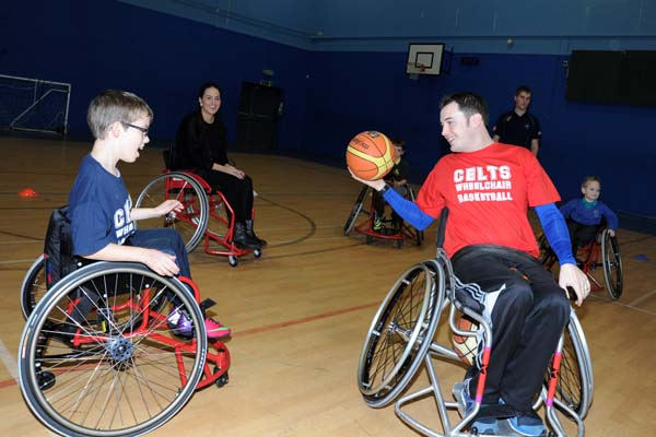 Members of the Wheelchair Basketball Club try out the new chairs