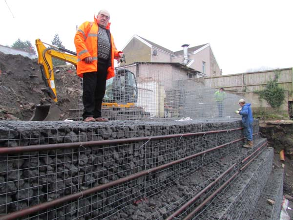 ALL IN ALL: Mario Sharley oversees construction of a gabion wall