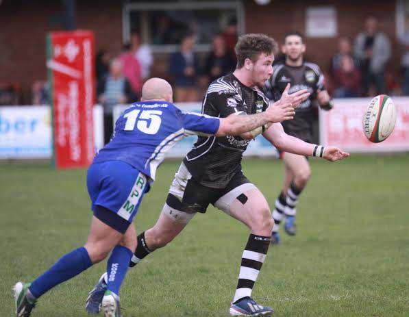 Lewis Hudd offloads for Bedwas