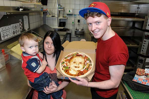 PEPPERONI PORTRAIT: Evan with his special pizza, mum Gemma and Nathan Wyburn Picture by Stephen J Rickards - www.firstlightphotography.co.uk