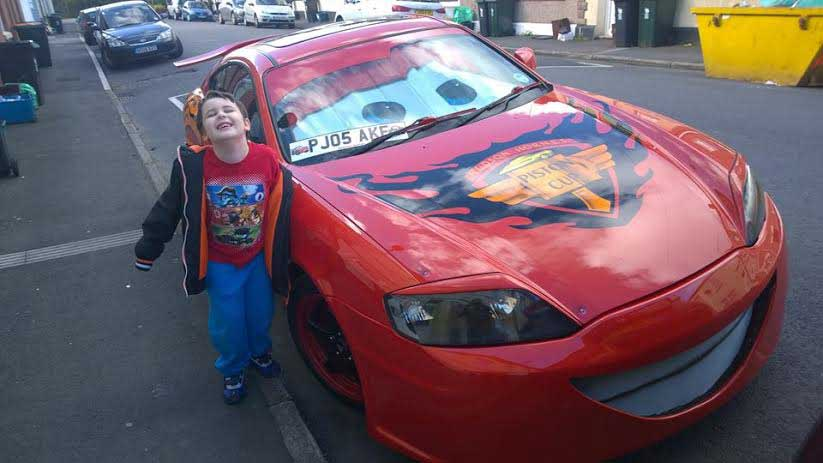 KA-CHOW: Seven-year-old Leo with his hero Lightning McQueen