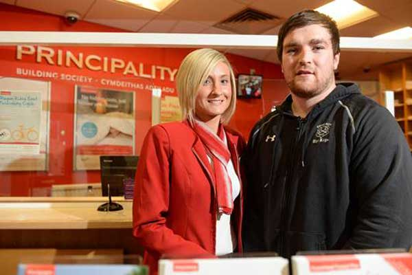 Principality Premiership Player of the Month, Scott Matthews, with Amy Adams of Blackwood Principality Building Society