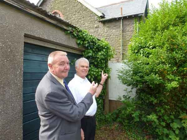 Councillors Colin Mann and Rob Gough at the proposed site fro a new health centre in Llanbradach