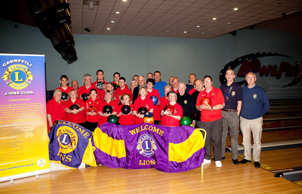 STRIKE: Members of Special Olympic Wales' ten pin bowling team with representatives from Caerphilly Lions Club