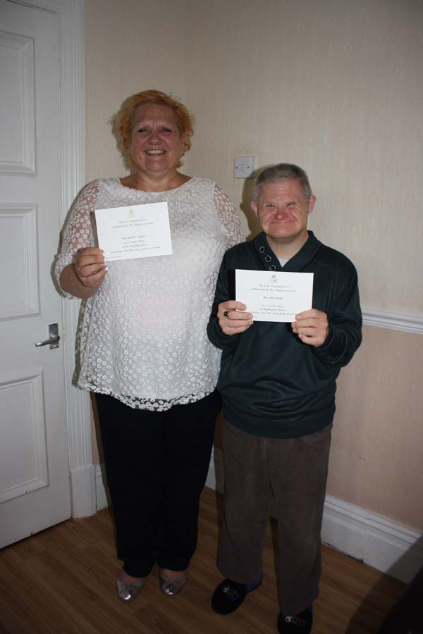 INVITE: Heather Organ (left) and Ceri Lloyd at Graig Road with their invitations to Buckingham Palace