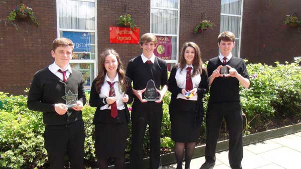 Hexaphone members with their Best Young Enterprise Company in Wales award