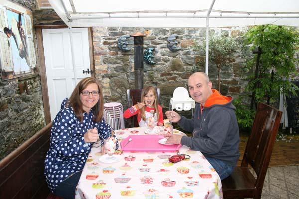HAPUS SUNDAE: Winner Chloe Bull, 8, with mum Leigh and dad Simon