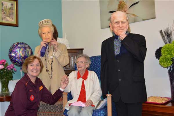 100-year-old May Wilkins with Linda Korczynski from Sainsburrys and some royal visitors