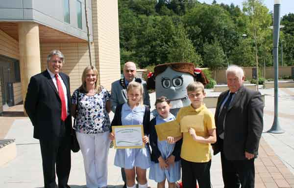 Fochriw Primary pupils Chianty Williams, Grace Jones and Brandon Evans are pictured with David Harding, Mrs Lisa Jones, Cllr David Carter, Bella the Battery and Cllr David Poole