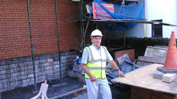 HARD WORK: Dedicated Howard Stone in what will become the memorial garden