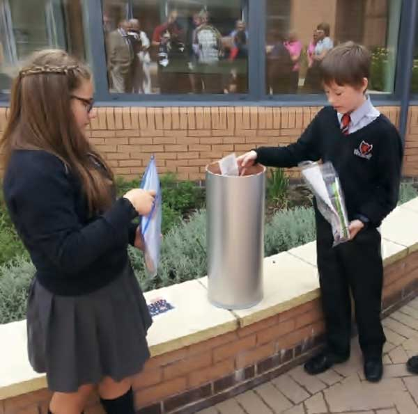 Manon Lewis and Ieuan Evans chose what to put into the time capsule