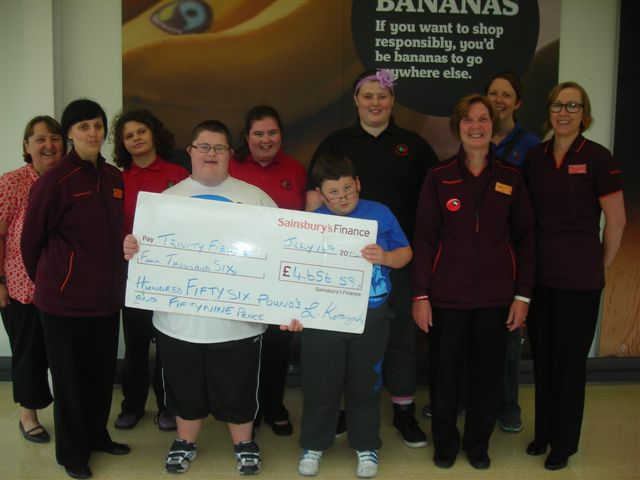 Pupils from Trinity Fields School received the cheque at Sainsbury's Pontllanfraith
