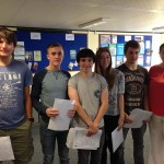 (left to right) Thomas Mitchell, 18, Rhys Turner, 17, Geraint Clash, 18, Sophie Rees, 18, Sam Stevens, and St Cenydd's headteacher Rebecca Collins.