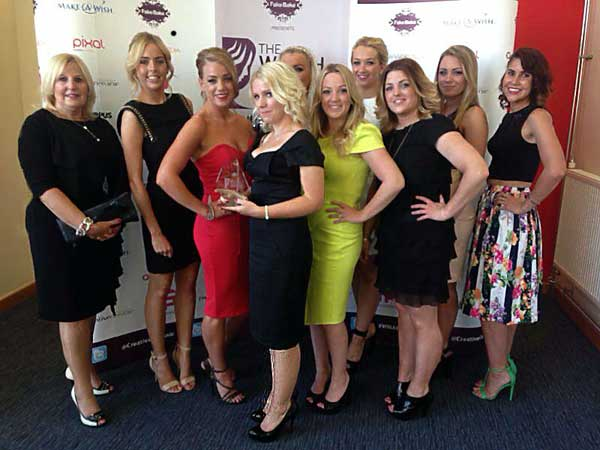 WINNERS: Captiva Spa's Managing Director Sarah Bruton (centre) with the rest of her team