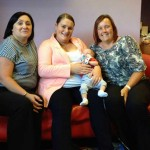 Lyn Bourne (left) and Cindy Baghurst (right) of Britannia Day Nursery with Zoe Fowler and son Olly