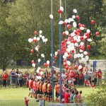 YOU'L' NEVER WALK ALONE: The players released balloons representing Jake Sweeney's beloved Liverpool FC