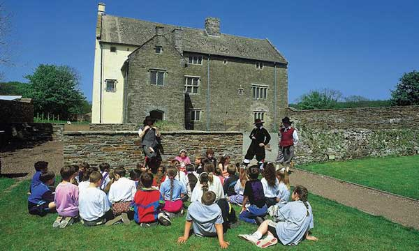 Schoolchildren being taught history at Llancaiach Fawr